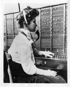 A Bell telephone switchboard operator from the early 1900's.