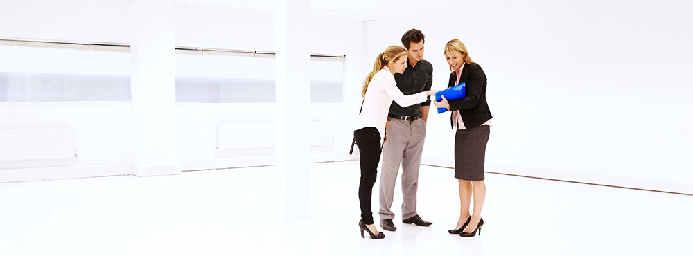 Small business owners looking at office space with a real estate agent