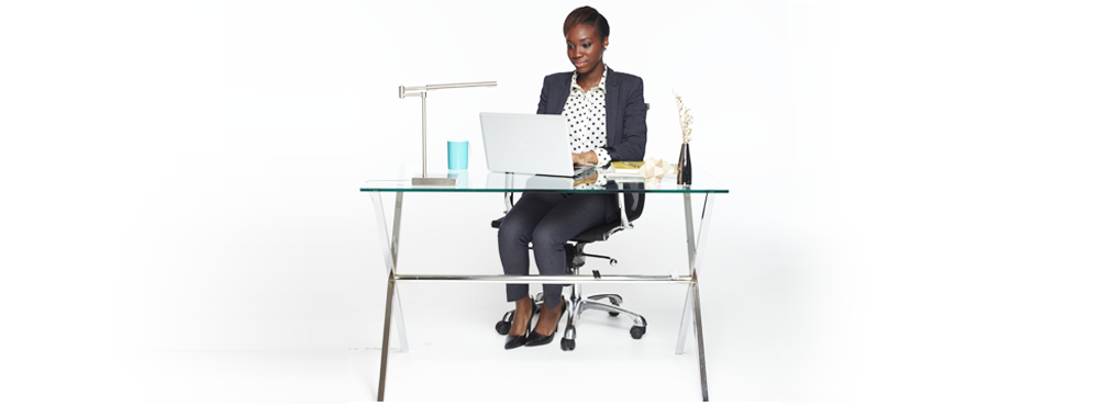 Woman at desk in office.